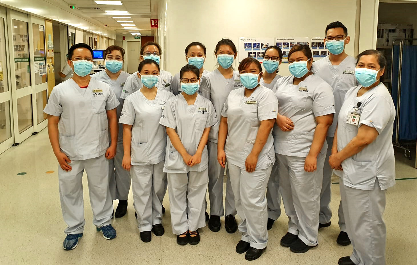 NC Syafiq (second from extreme right) has been working at Ward 68 for five years and manages a team of 15 nurses. He started out at Ward 73 (Internal Medicine) ten years ago.